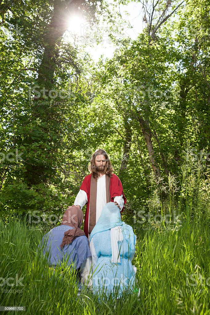 Jesus Blessing Couple in Woods stock photo