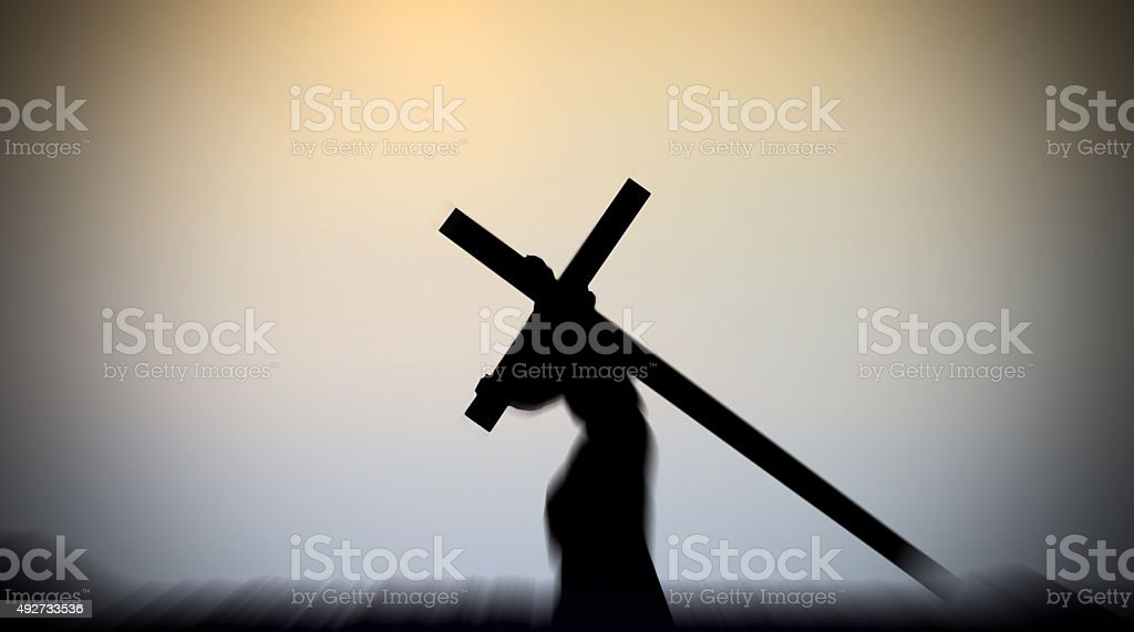 Jesus Christ Carrying the Cross with light background stock photo