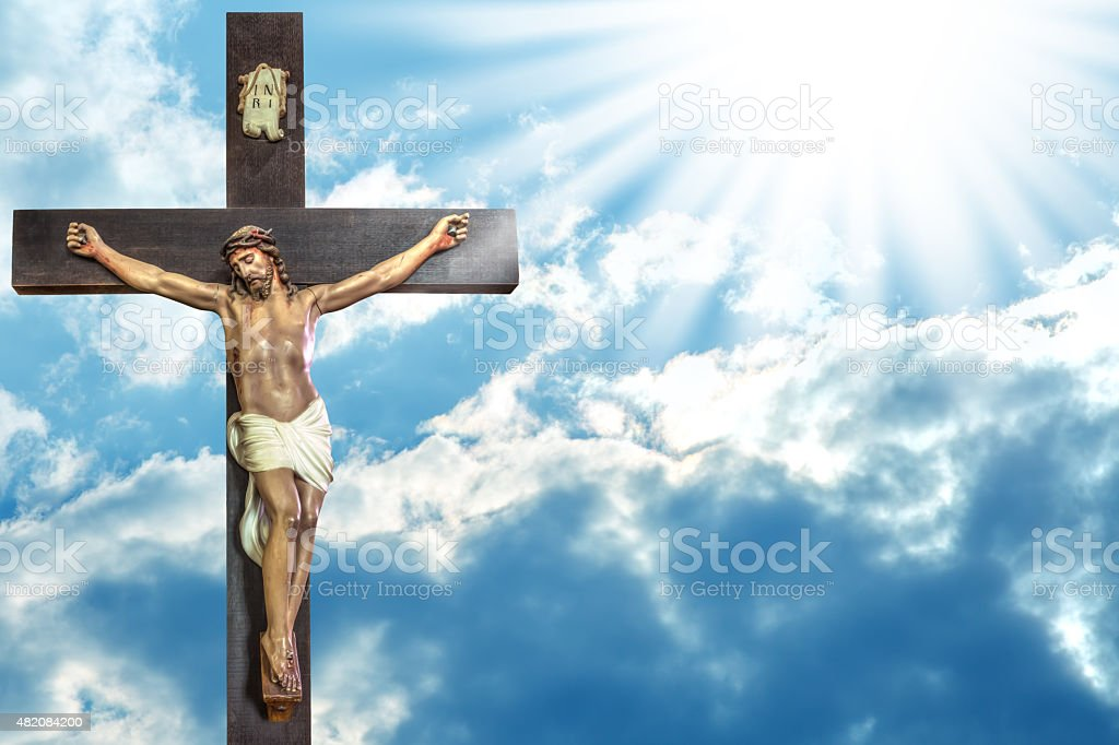 cross of Jesus Christ on sky background with a shining celestial...