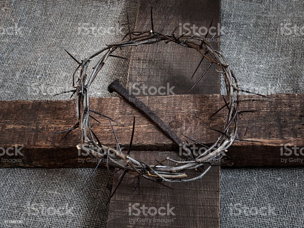 Jesus Christ crown of thorns on the holy cross stock photo
