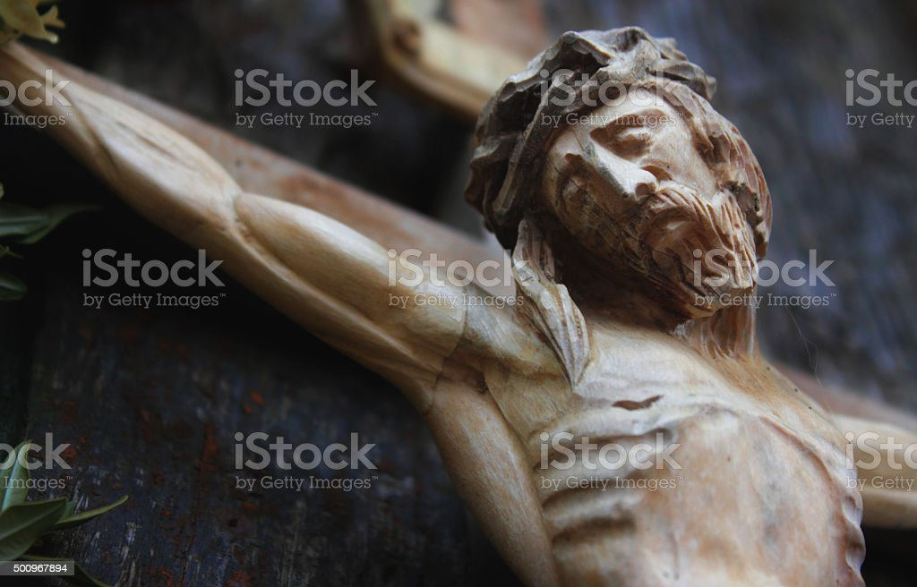 Jesus Christ crucified (an ancient wooden sculpture) stock photo
