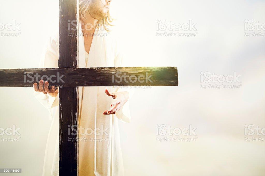 Jesus Christ Holding Cross stock photo