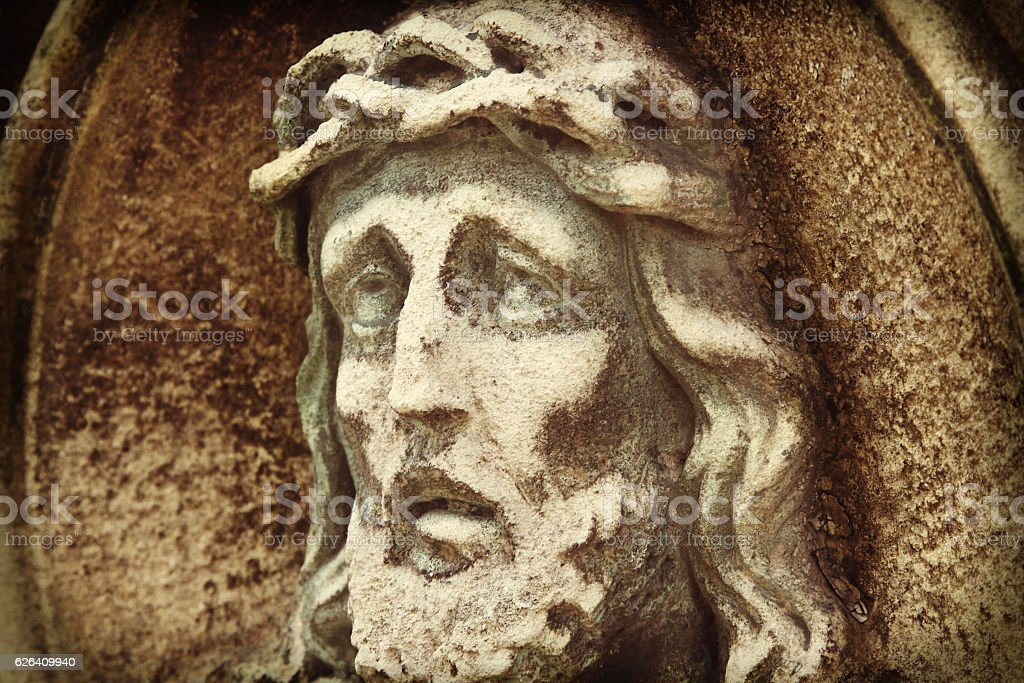 Jesus Christ in a crown of thorns (fragment of statue) stock photo