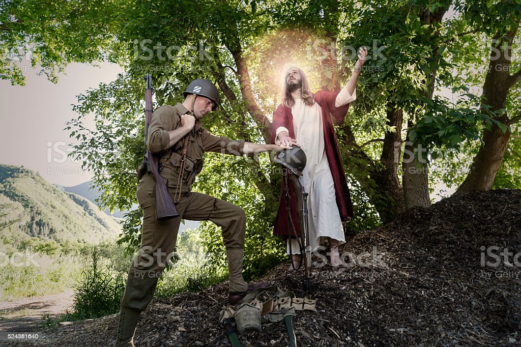 Jesus Christ Look Up While a Soldier Prays stock photo
