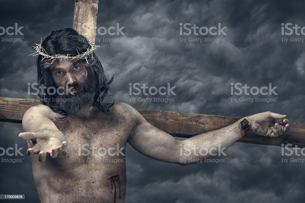 Jesus Christ on cross reach out stock photo