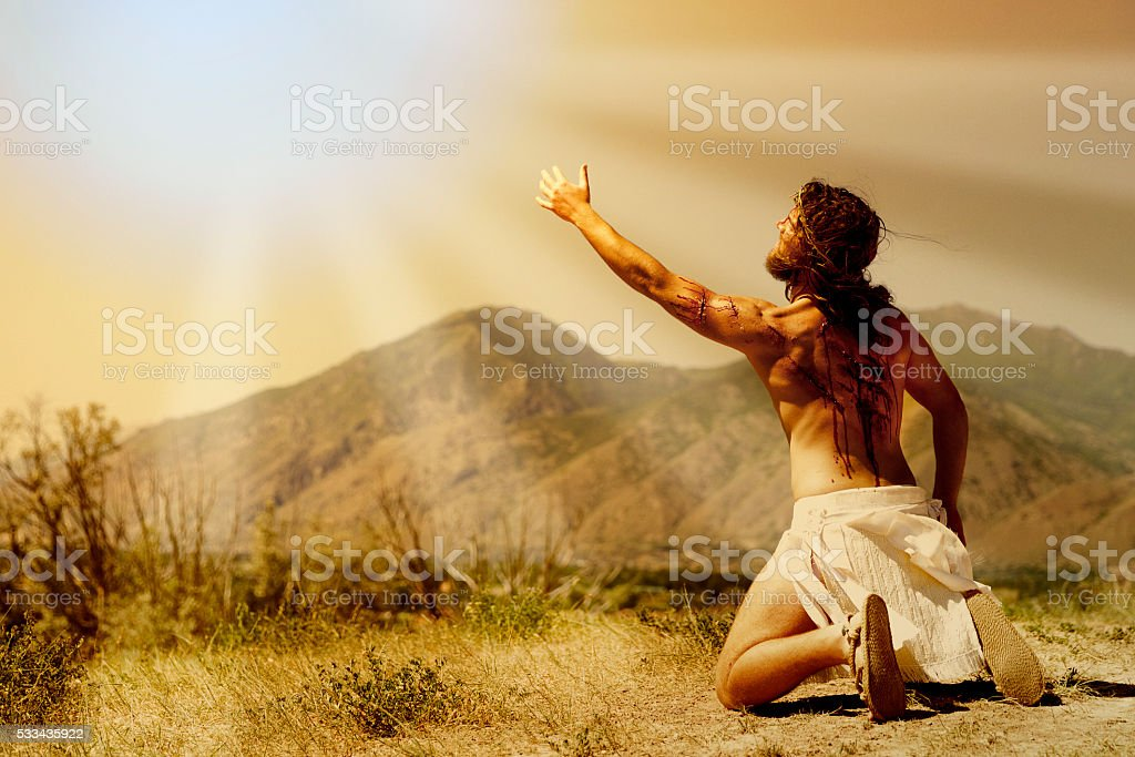 Jesus Christ reaching out to heaven. stock photo