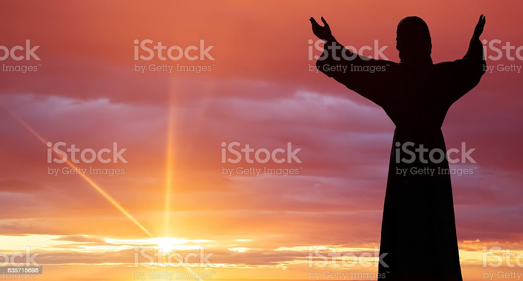 Jesus Christ statue against beautiful sky background stock photo