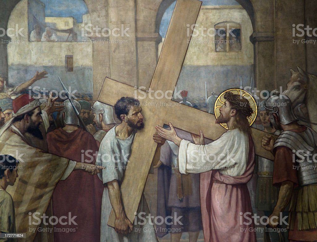 Jesus Christ taking on the cross royalty-free stock photo