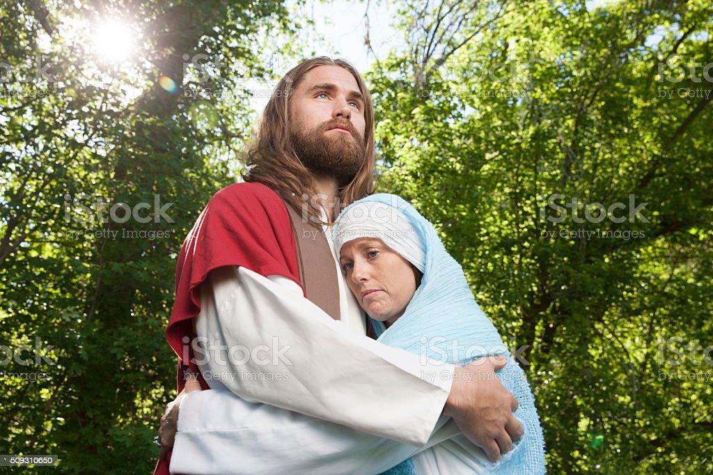 Jesus Consoling Sad Woman stock photo