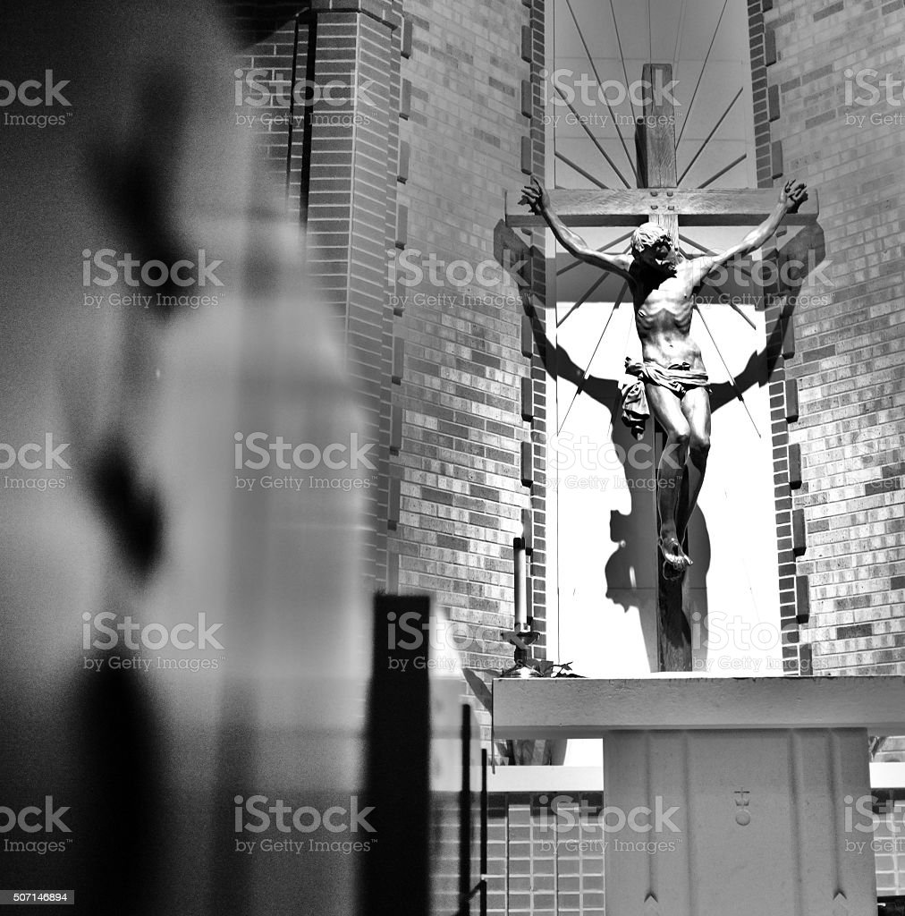 Jesus crucified hanging on the holy wooden cross of salvation stock photo