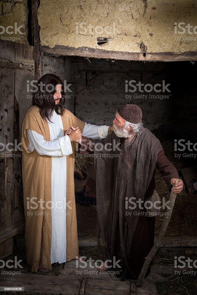 Jesus curing the crippled man stock photo