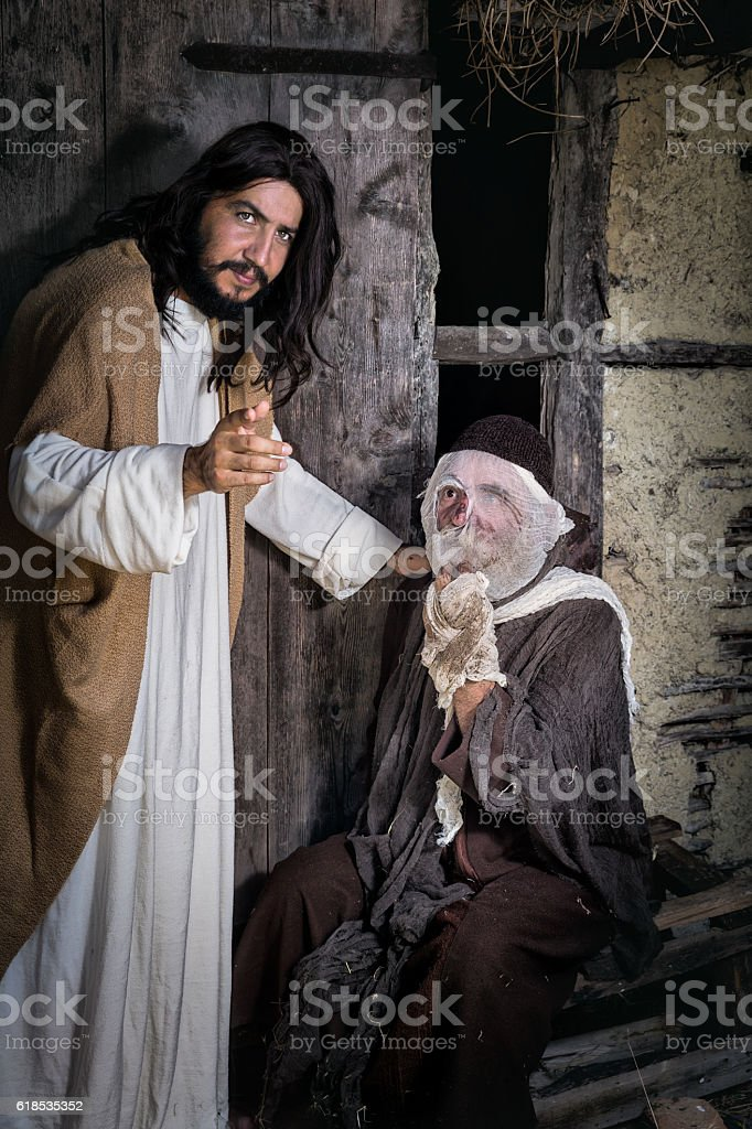 Jesus healing the leper stock photo