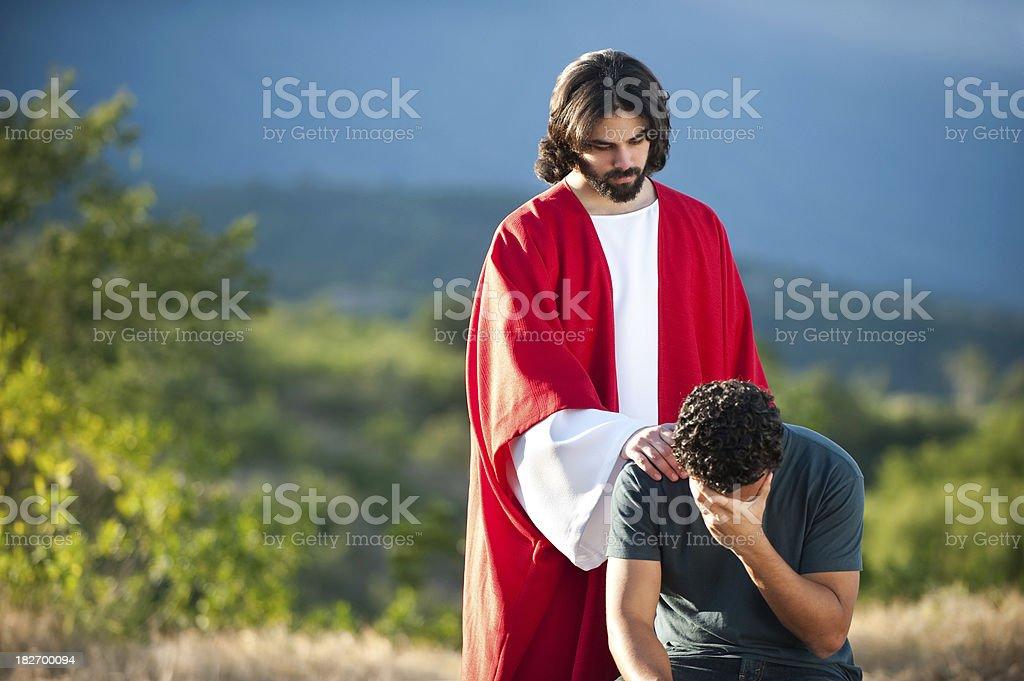 Jesus helping a man royalty-free stock photo