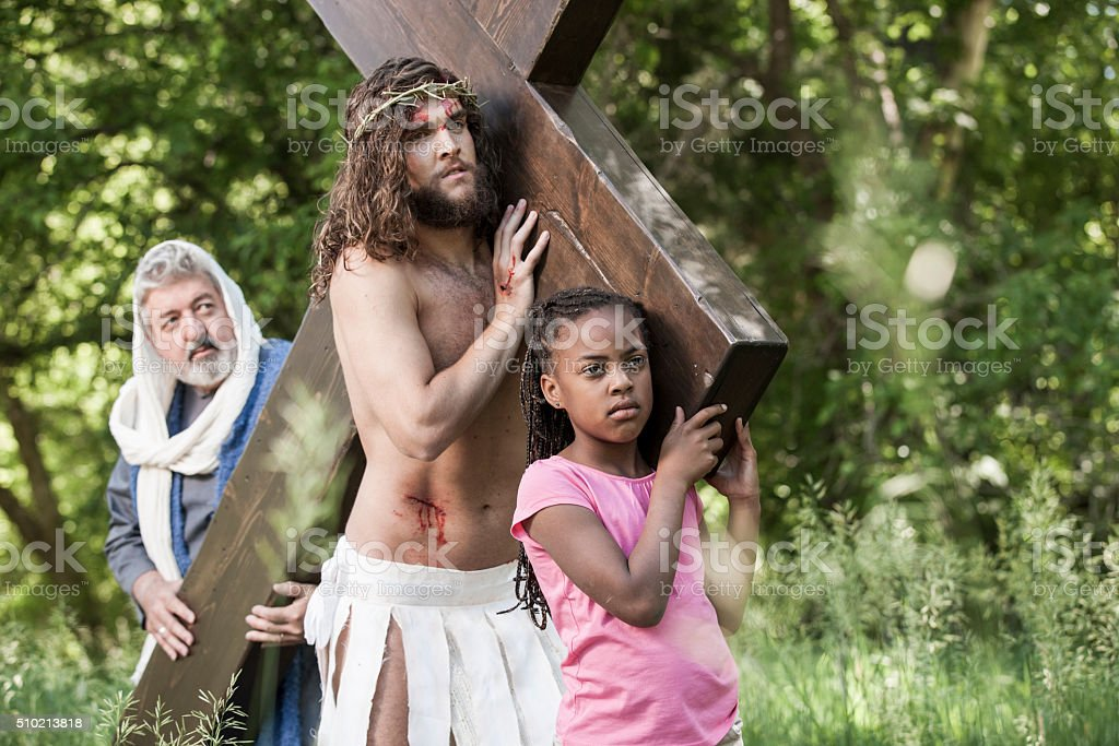 Jesus Helping Girl and Apostle to Carry the Cross stock photo