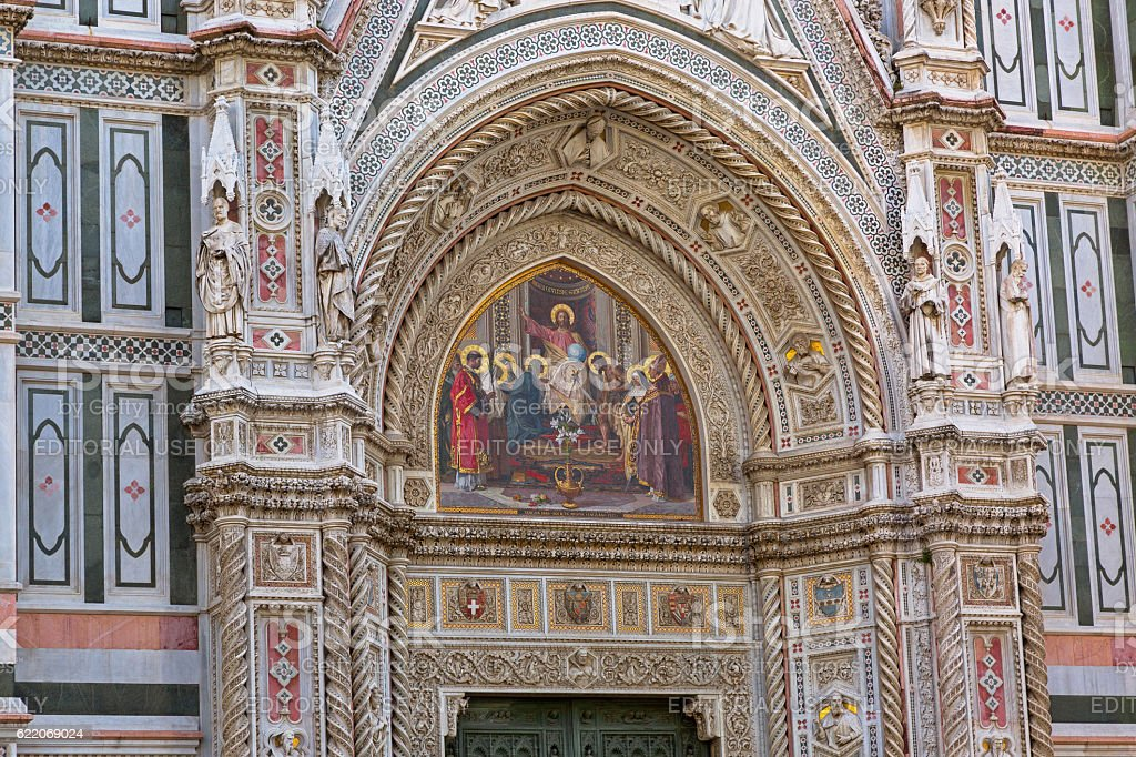 Jesus holding globe mosaic on Florence Cathedral door in Italy stock photo