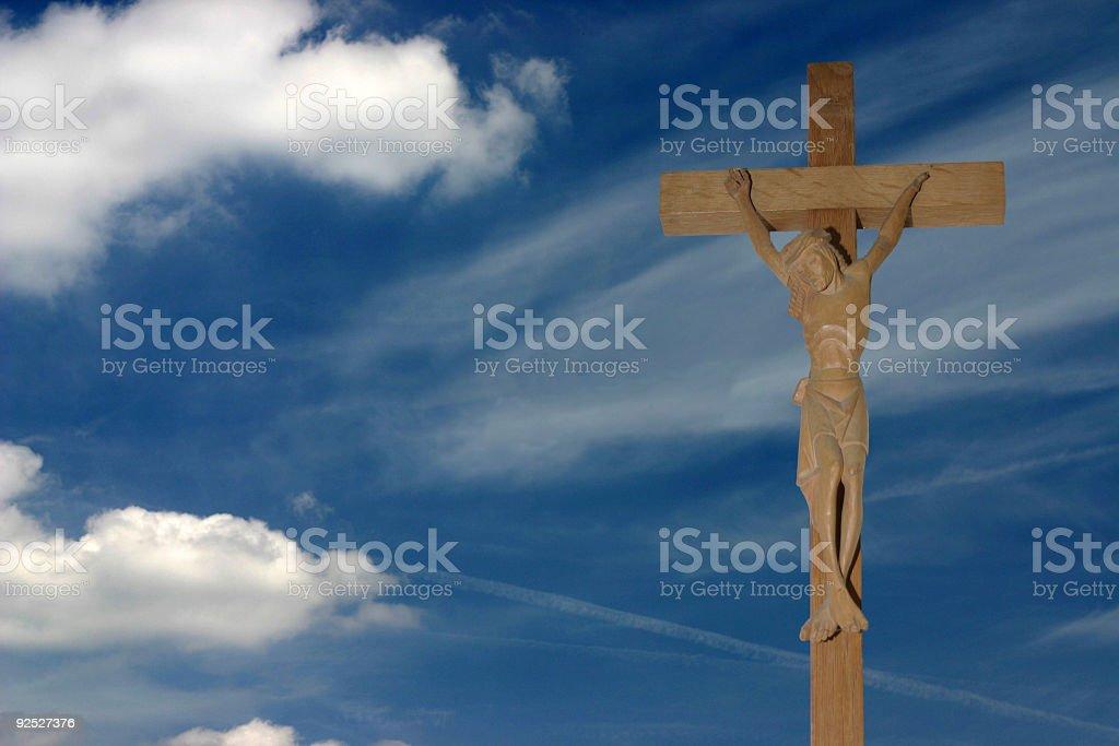 Jesus in front of blue sky stock photo