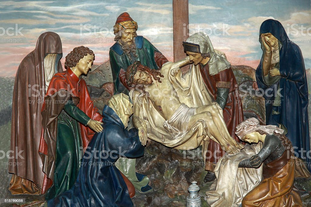 Jesus is taken down from the cross stock photo