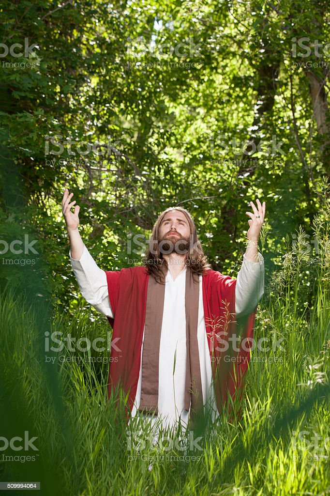 Jesus Lifting Arms to the Heavens stock photo