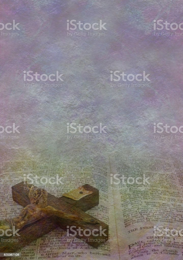 Jesus on the cross figure on rustic stone effect background with copy...