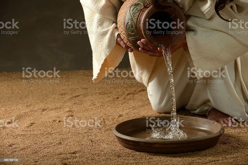 Jesus pouring water stock photo