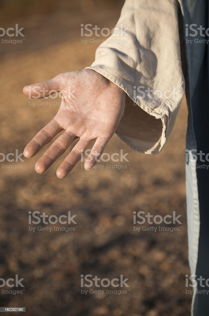 Jesus Reaching Out stock photo