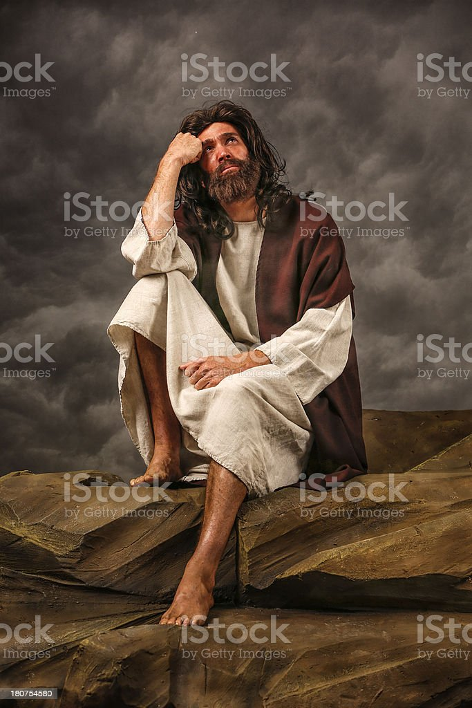 Jesus Sitting on rock looking up royalty-free stock photo