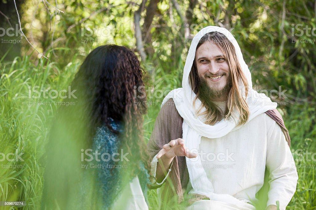 Jesus Talks with Woman stock photo