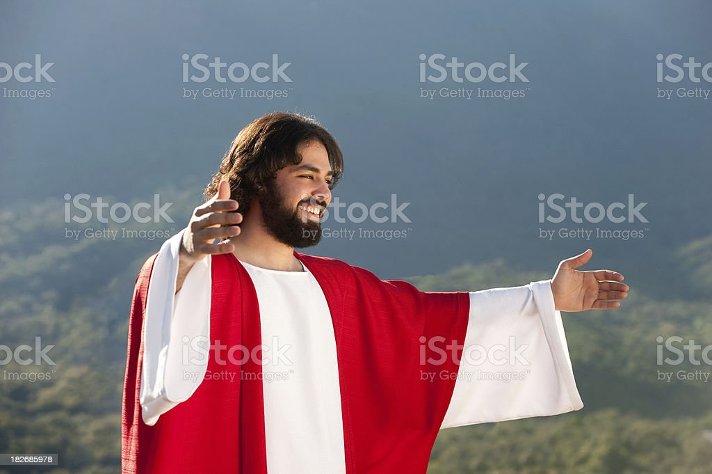 Jesus with his arms open stock photo