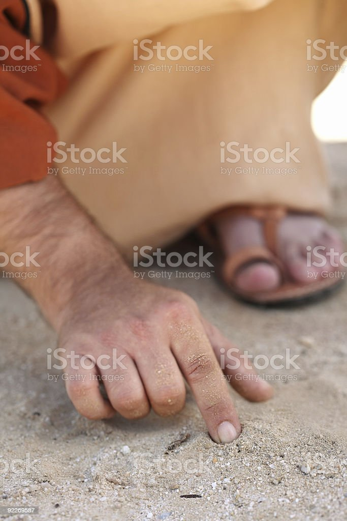 Jesus writing with his finger royalty-free stock photo