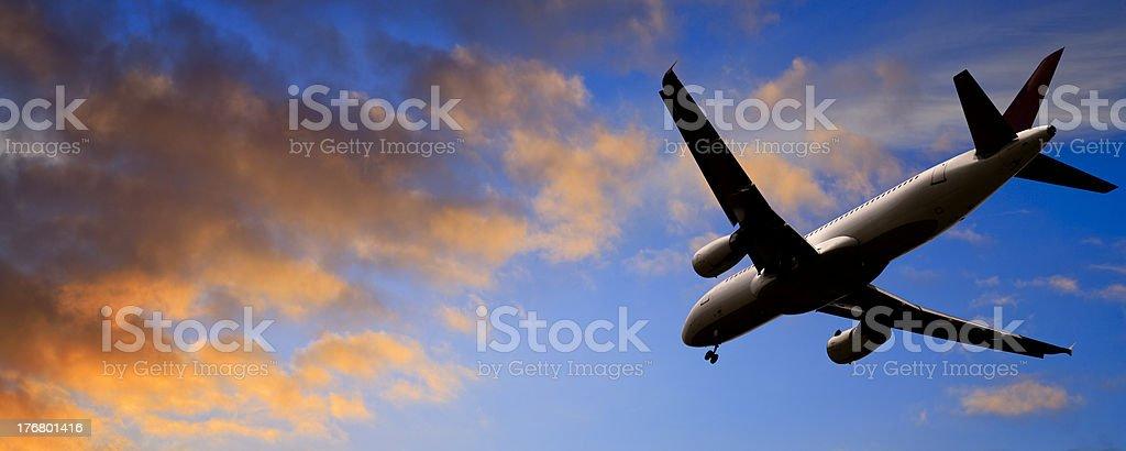 Jet Aeroplane Landing at Sunset Rear View Panoramic royalty-free stock photo