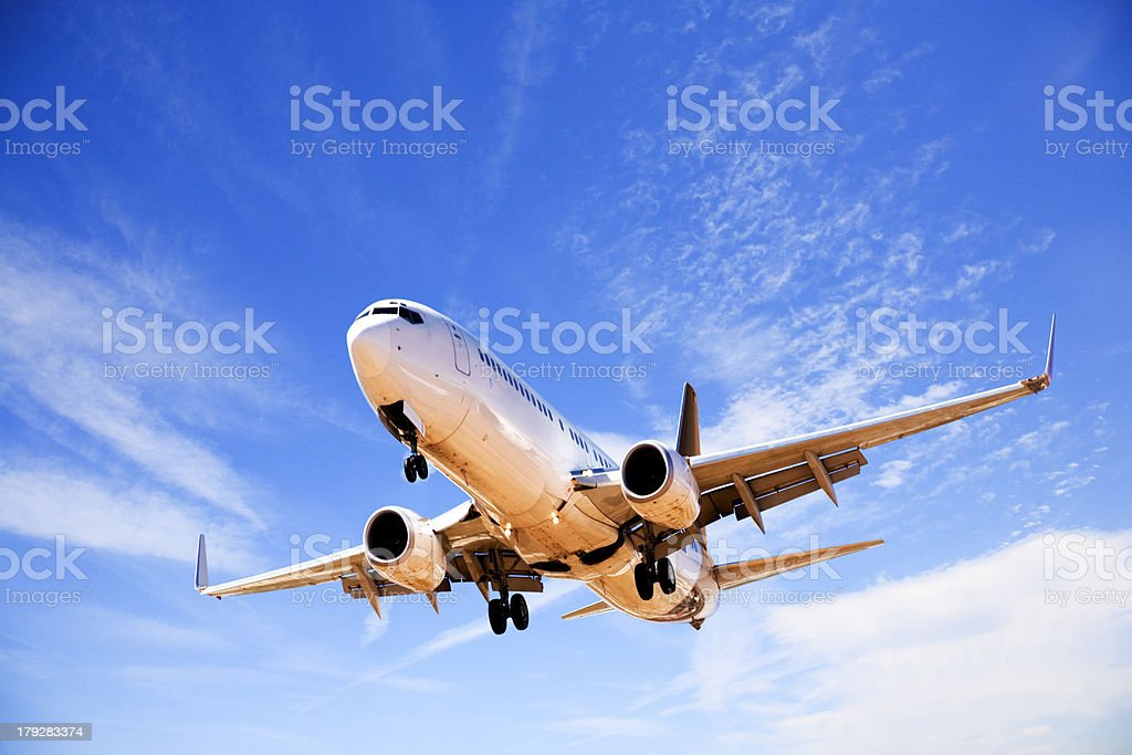 Jet Aeroplane Landing From Beautiful Blue Summer Sky royalty-free stock photo