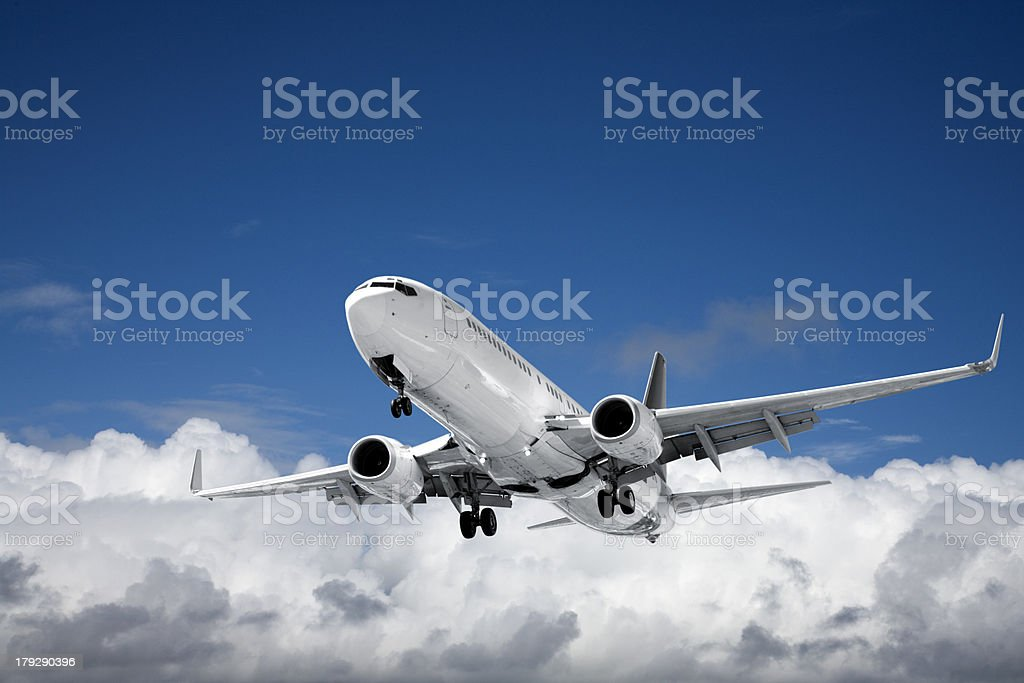 Jet Aeroplane Landing from Bright Sky Copy Space stock photo