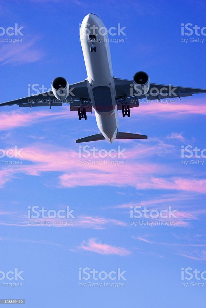 Jet Aeroplane Landing From Bright Twilight Sunset Sky royalty-free stock photo