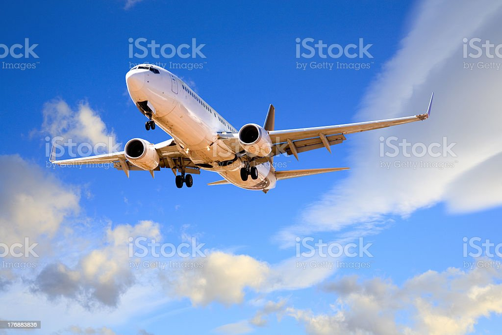 Jet Aeroplane Landing from Summer Evening Sky stock photo