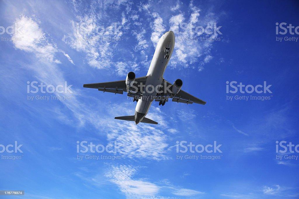 Jet Aeroplane Landing From Sunny Blue Sky royalty-free stock photo