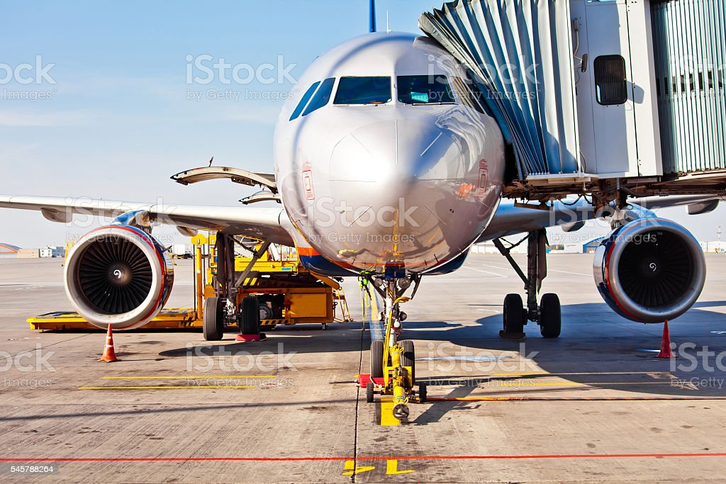 Jet aircraft in airport stock photo