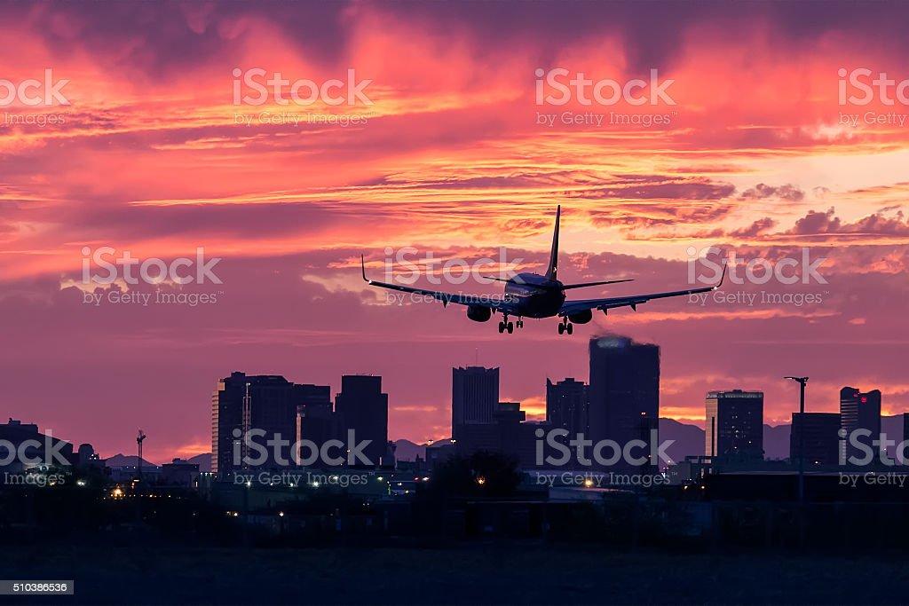 Jet Airliner Landing at Sunset. stock photo