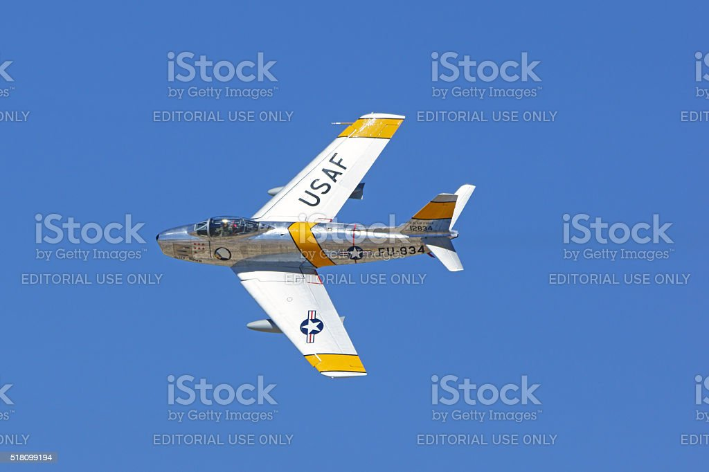 Jet airplane F-86 Sabre flying stock photo