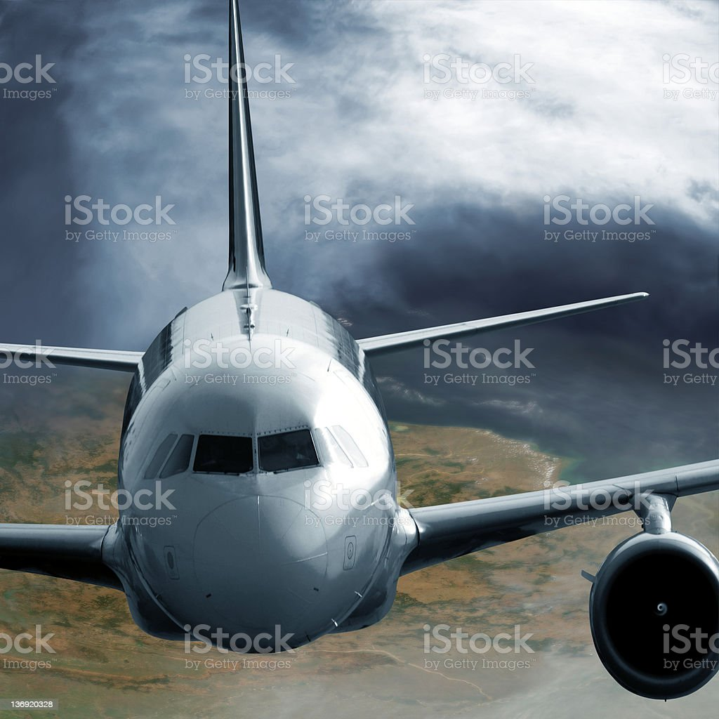 jet airplane flying at high altitude royalty-free stock photo