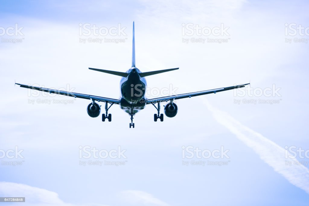 Jet airplane flying overhead close-up stock photo