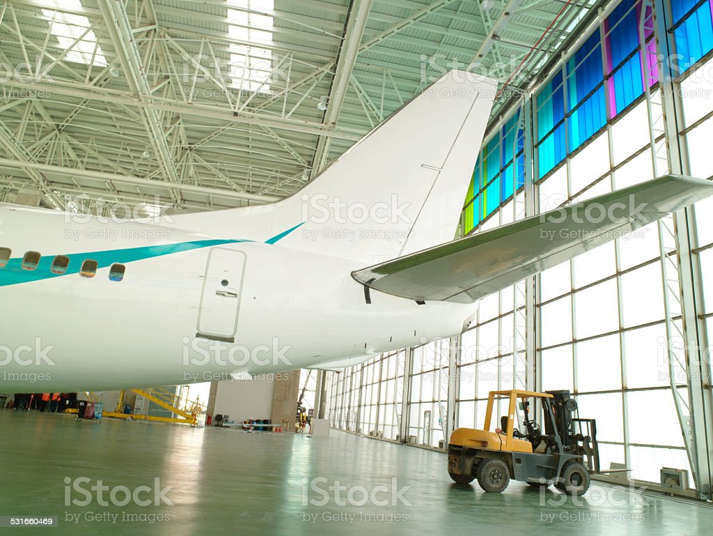 Jet airplane in a hangar stock photo