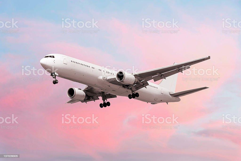 XXL jet airplane landing at dusk royalty-free stock photo