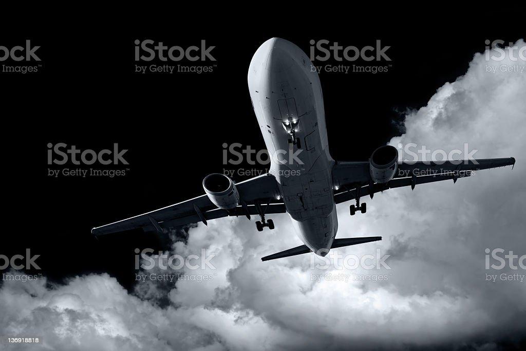 XL jet airplane landing at night royalty-free stock photo