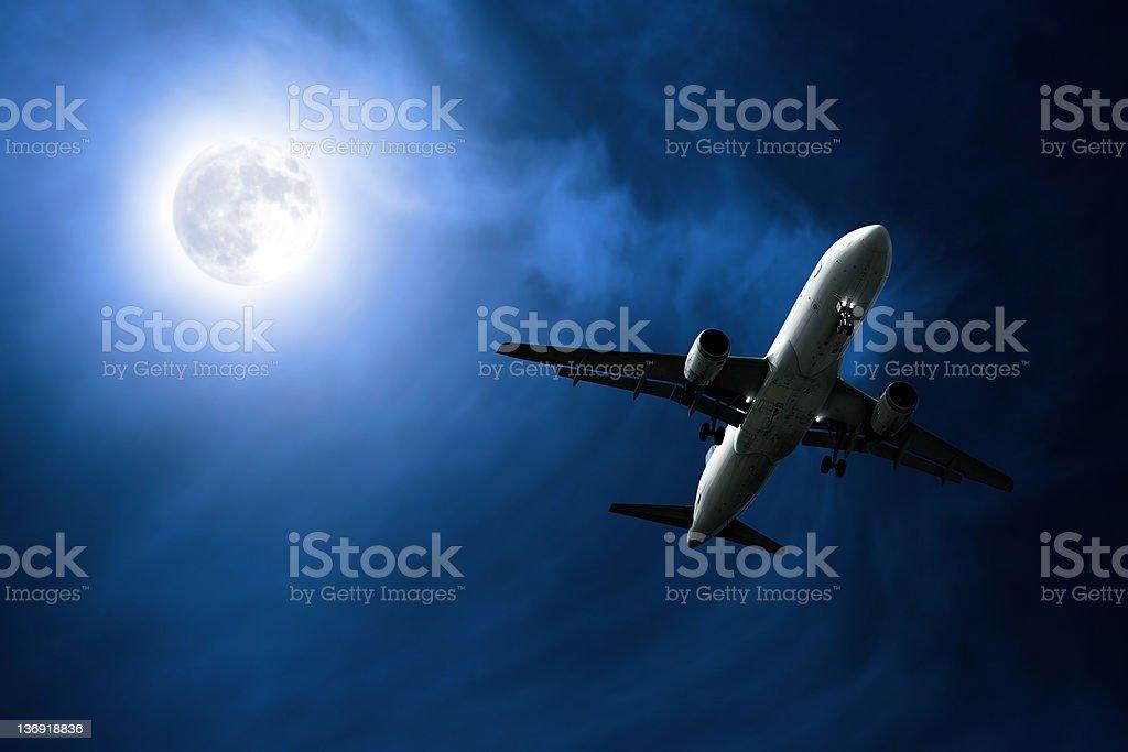 jet airplane landing at night royalty-free stock photo