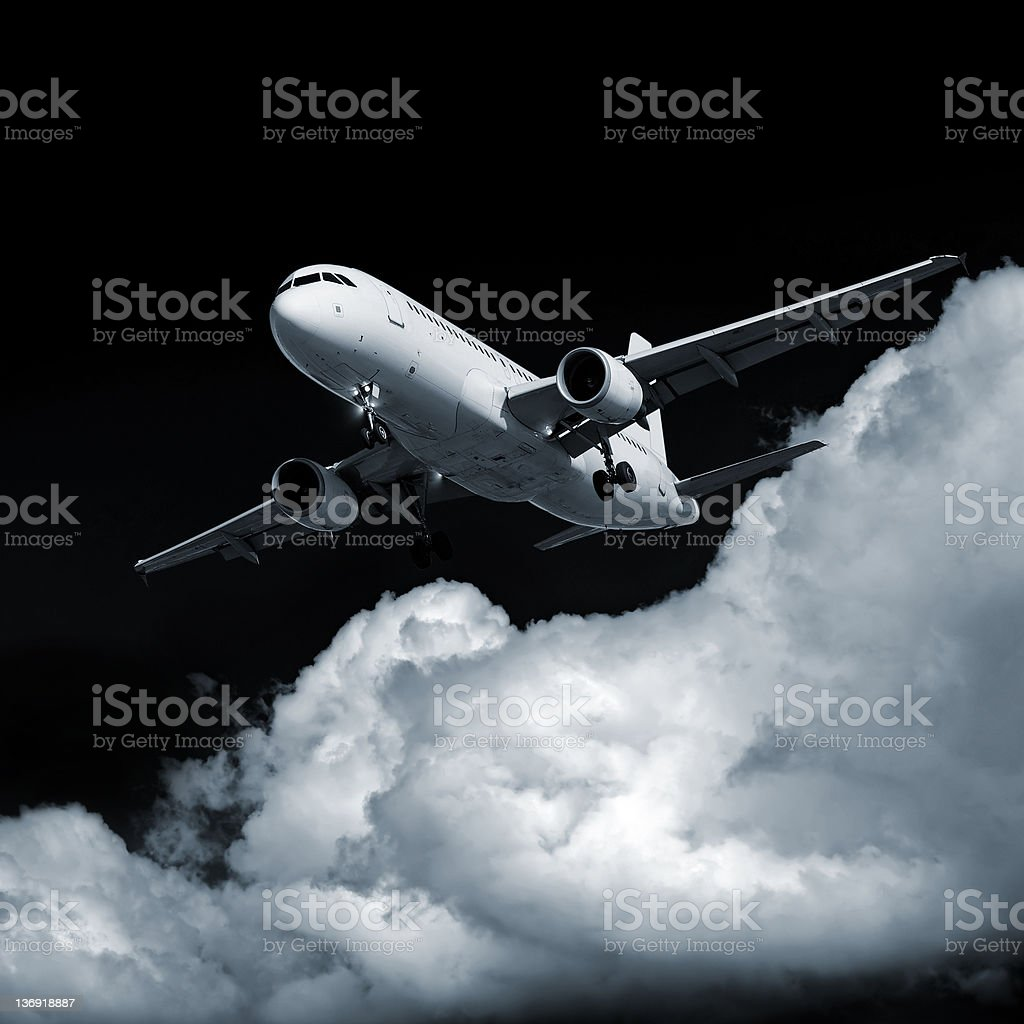 XL jet airplane landing at night royalty-free stock photo