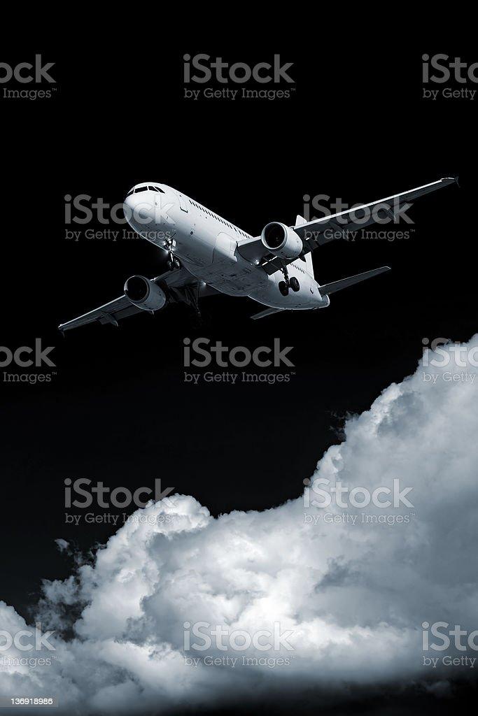 XXL jet airplane landing at night royalty-free stock photo