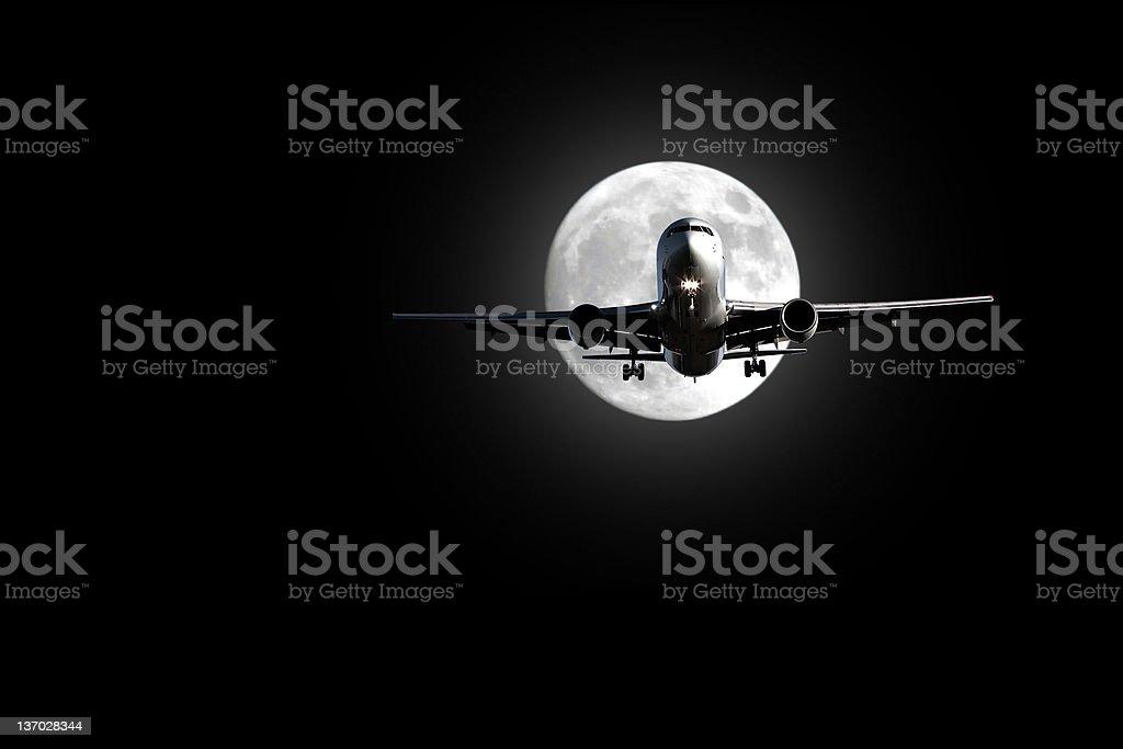 jet airplane landing at night stock photo