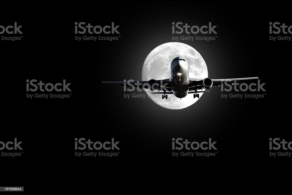 jet airplane landing at night stock photo
