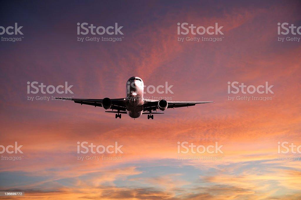 XXL jet airplane landing at sunset royalty-free stock photo