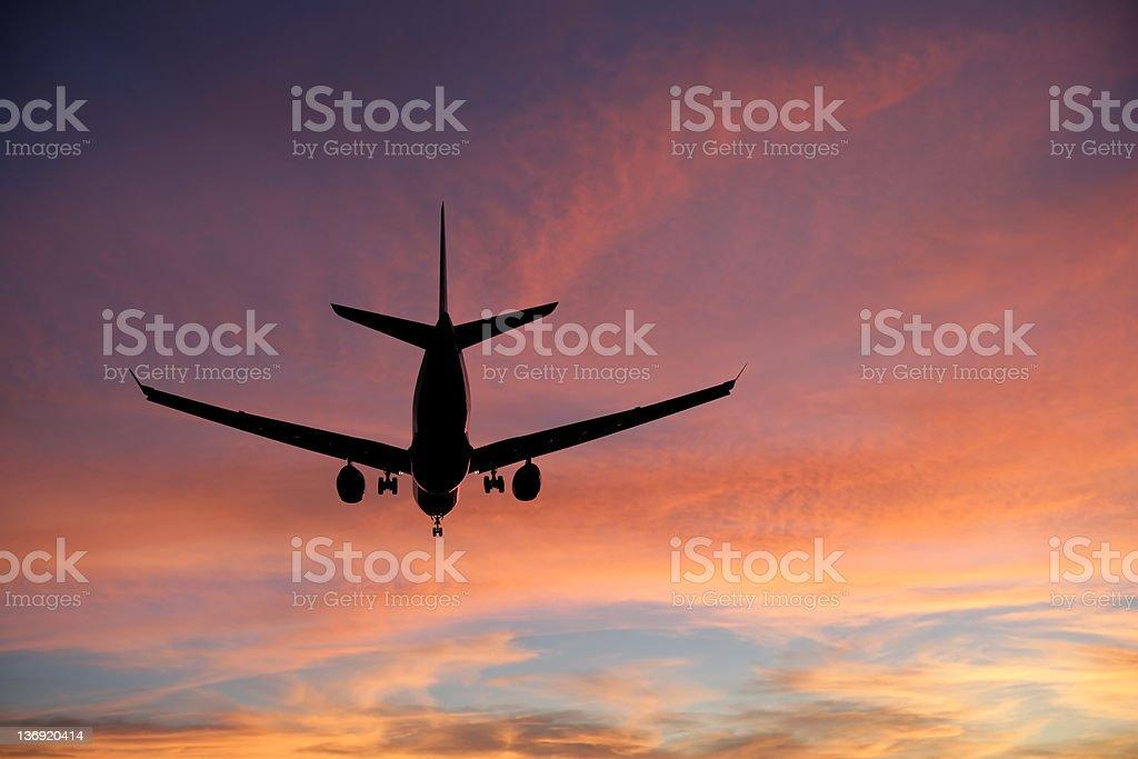 XXXL jet airplane landing at sunset stock photo